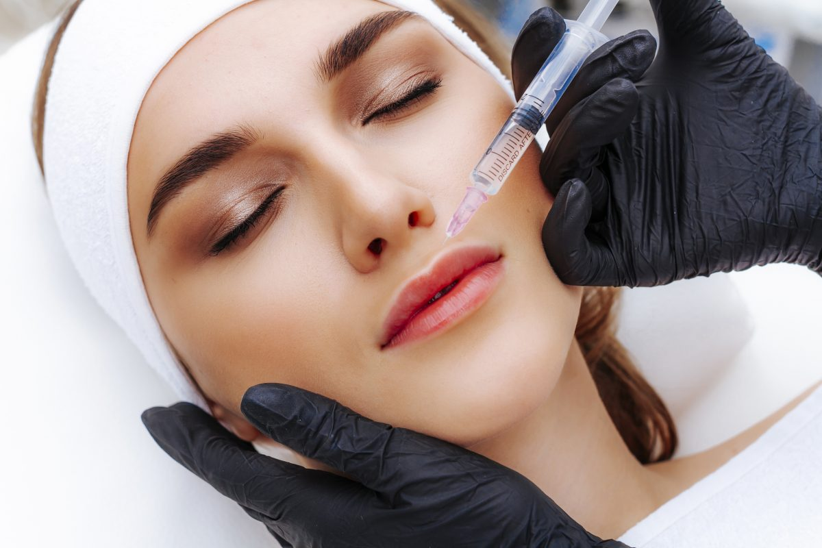 lip-augmentation-procedure-with-hyaluronic-acid-the-beautician-pierces-the-lips-with-needle-subcutaneous-injection-1200x800.jpg
